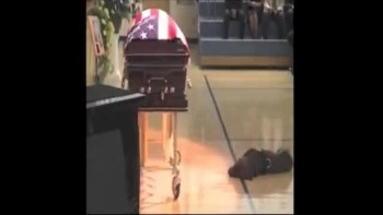 Loyal Dog of Fallen Navy Seal Doesn't Leave His Side