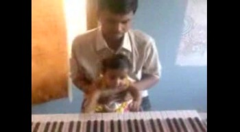 5 month old baby Sheba playing keyboard