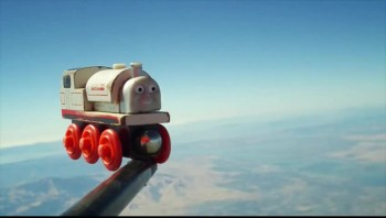 A beautiful father, son moment - A toy train in space