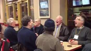 Charming Men Break Out Singing While Having Coffee