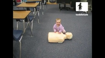 Smart Baby Gives CPR on a Dummy - Future Med Student! :)