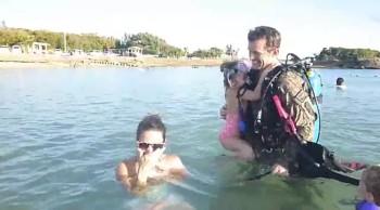 Soldier Surprises Family Dressed As Scuba Diver