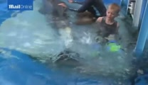 Double Amputee Swims With Disabled Dolphin