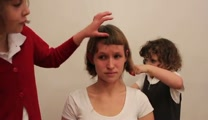 Courageous Big Sister Lets Her Little Sisters Give Her a Makeover...That Includes a Hair Cut