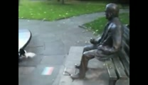 Dog Tries to Get Statue to Play Fetch