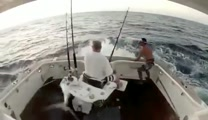 Fish Jumps Into Boat. . .Man Jumps Out! Too Funny!