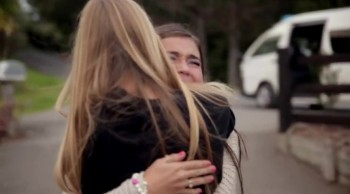Emotional Meeting of Two Girls Who are Both Missing an Arm