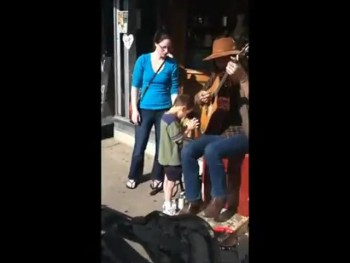 Blind Boy With Autism Stops to Have an Incredible Moment With a Street Performer