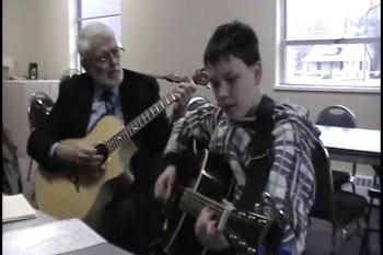 Alex sings Three Wooden Crosses