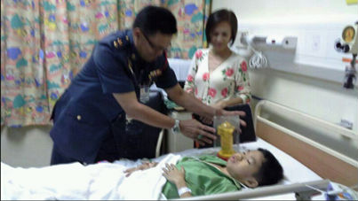 Huguan in being treated at the hospital.