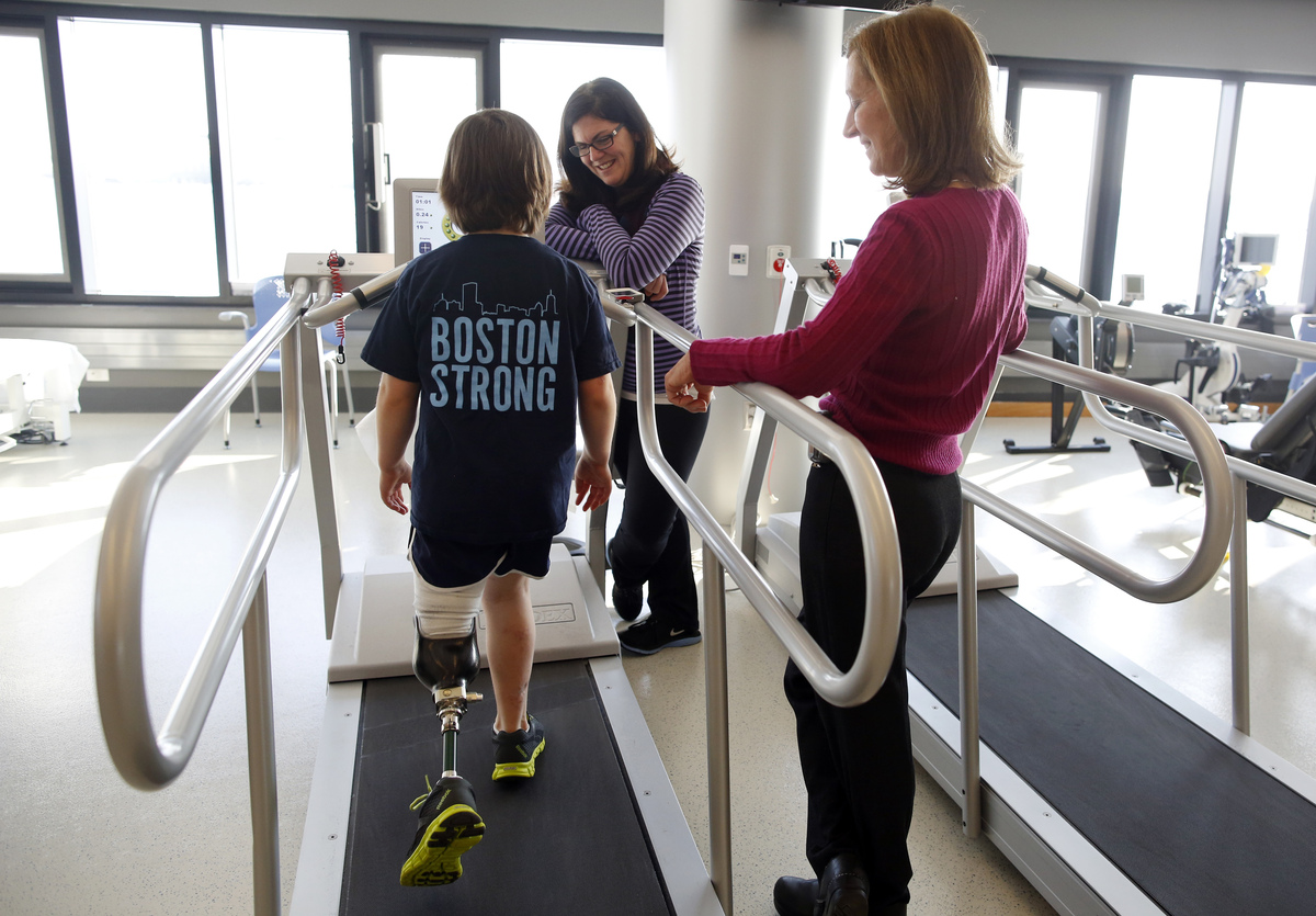 Jane is learning to walk with her prosthetic leg.