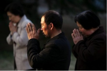 Church members praying.