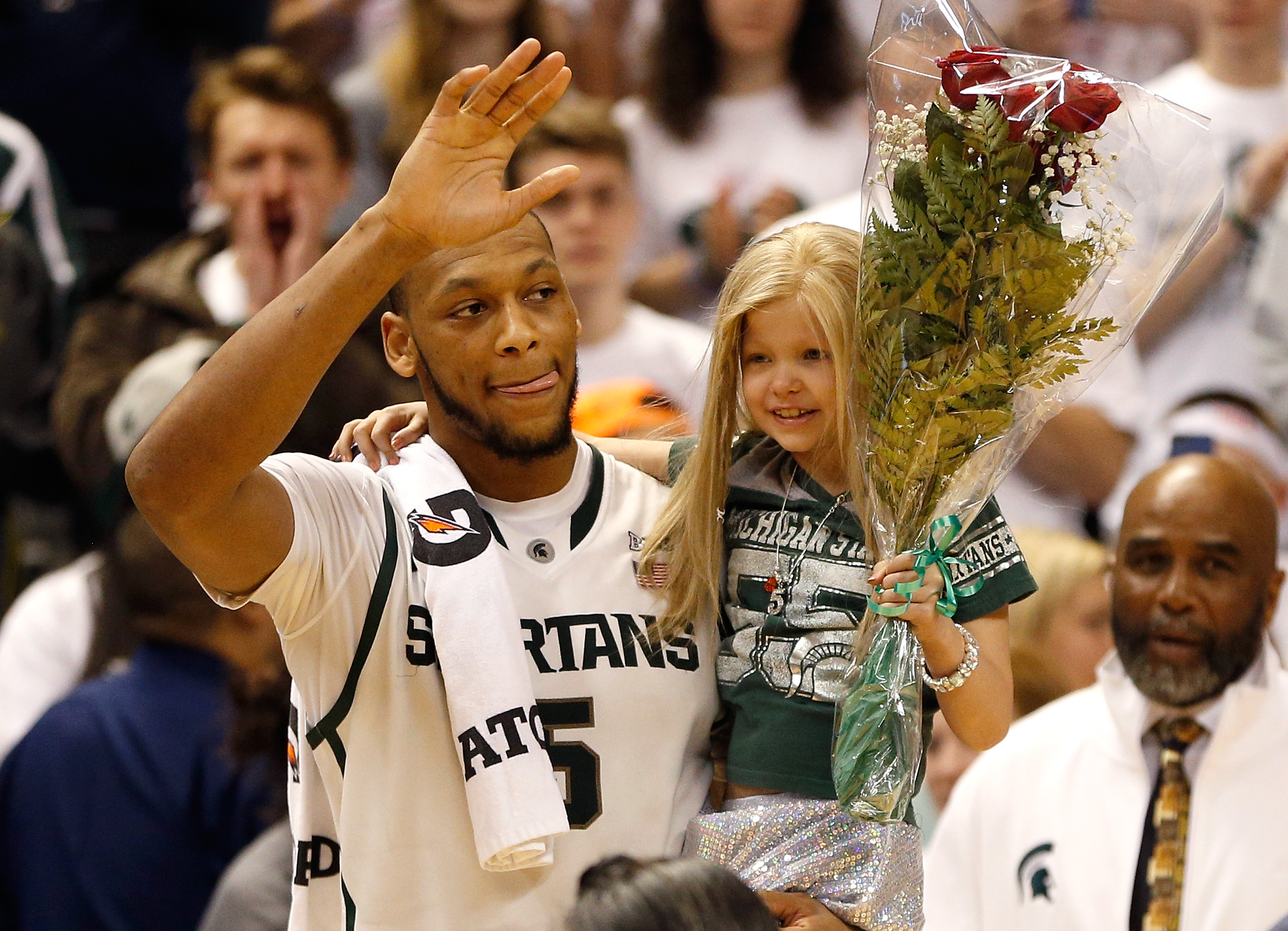 Princess Lacey with Michigan State Basketball Player