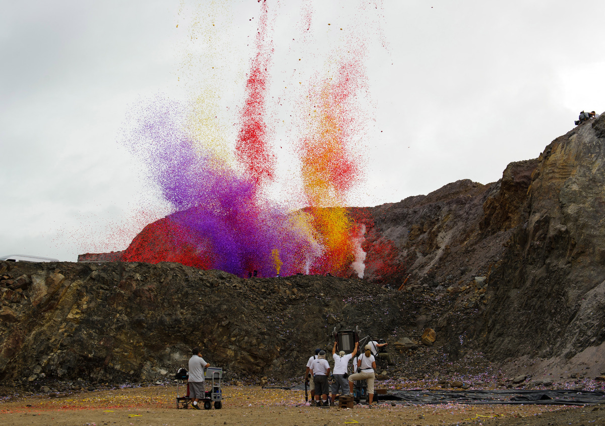 Volcano erupts many different color flower pedals.