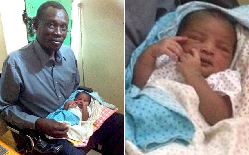 Dad Holds Sudan Baby Born in Prison