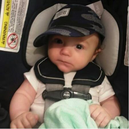 flight attendant keeps baby happy