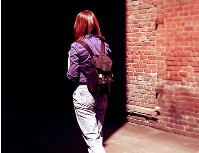 Girl walks through ally.