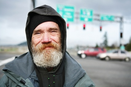 Heroic homeless man smiles