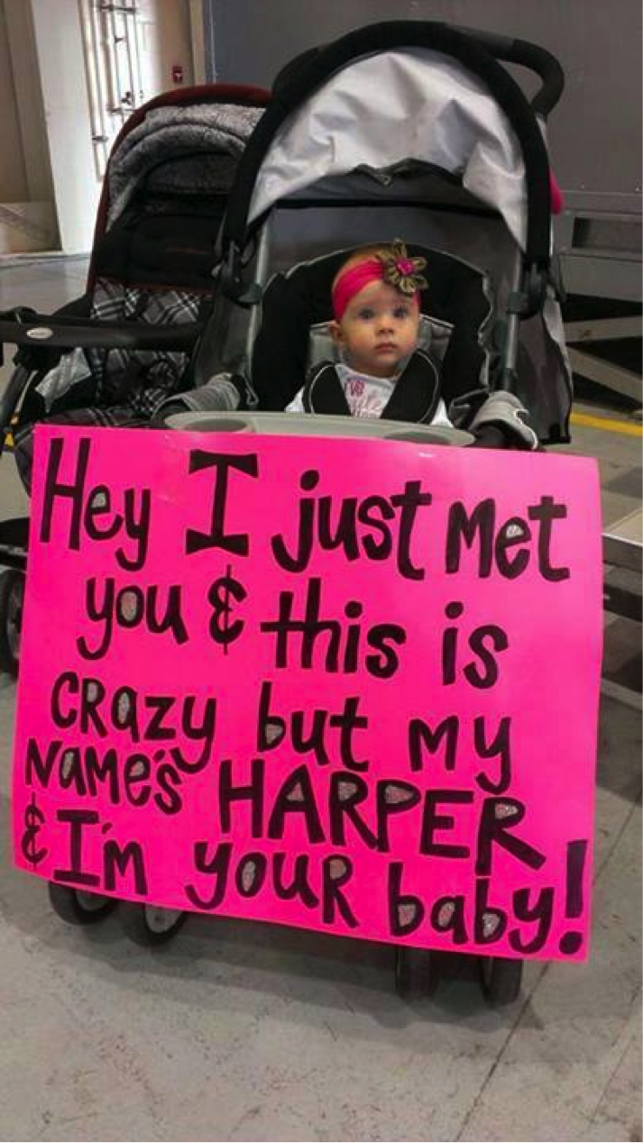 Adorable Baby Harper Holds Up a Sign to Greet Her Daddy