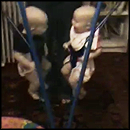 Adorable Twins Giggling Uncontrollably in Jolly Jumpers