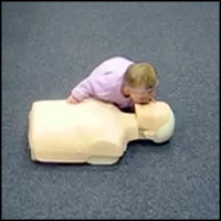 Genius Baby Gives CPR Perfectly to a Dummy