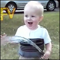 Cute Baby Tries to Drink Water From a Hose