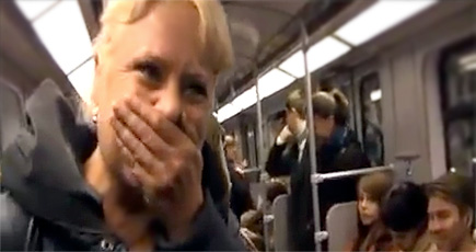 A Simple Giggle Turned Into Something MUCH Bigger in This Subway Car - We Bet You Laugh, Too!