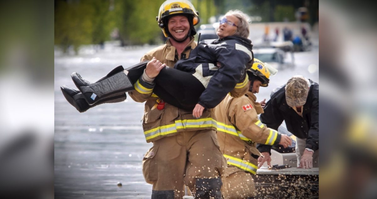 Smiling Firefighter: The Heartwarming Truth Behind His Grin!
