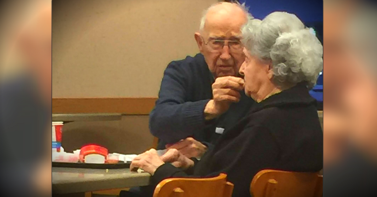 Elderly Man Feeding His Wife With Alzheimer's Is The Picture Of True Love