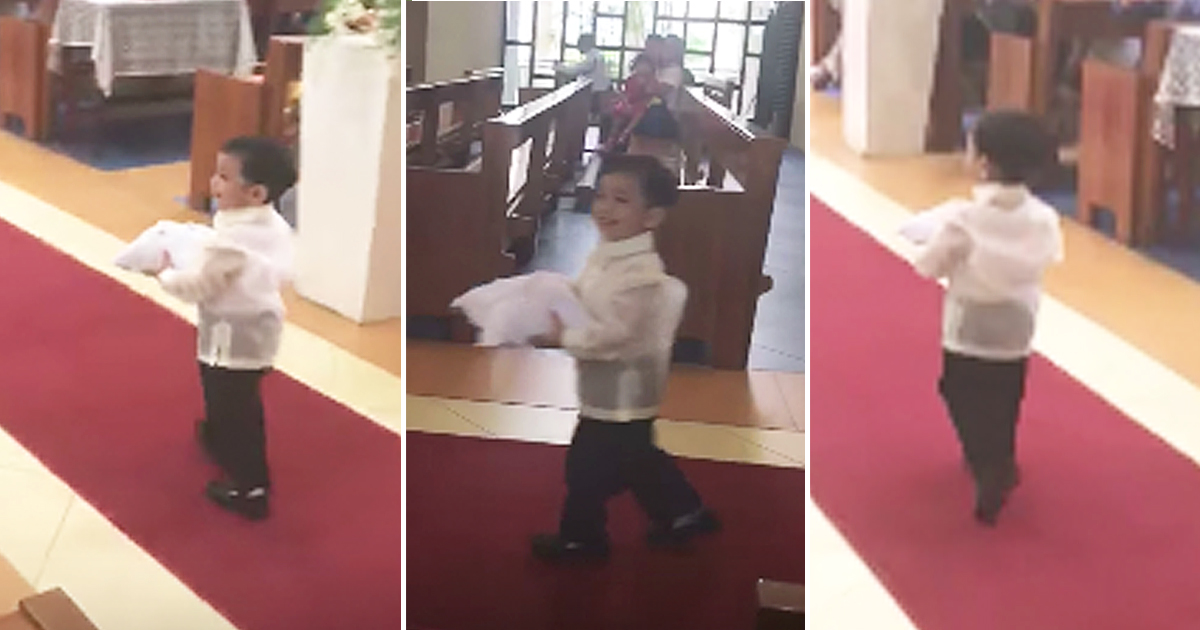 Ring Bearer Adorably Tosses His Pillow While Walking Down Aisle